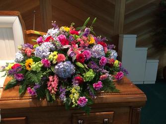 Uplifting Spring Casket Spray from your Sebring, Florida florist