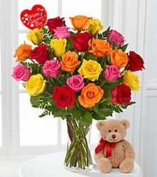 Two dozen mixed roses in a vase from your Sebring, Florida florist